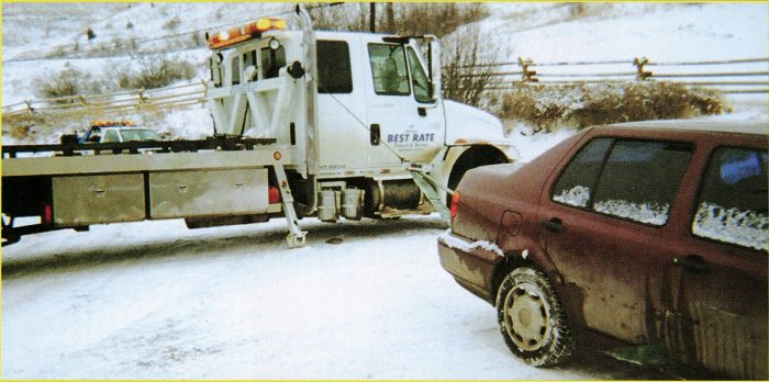 Towman Of The Year Page 3, Tow truck side pulling a car